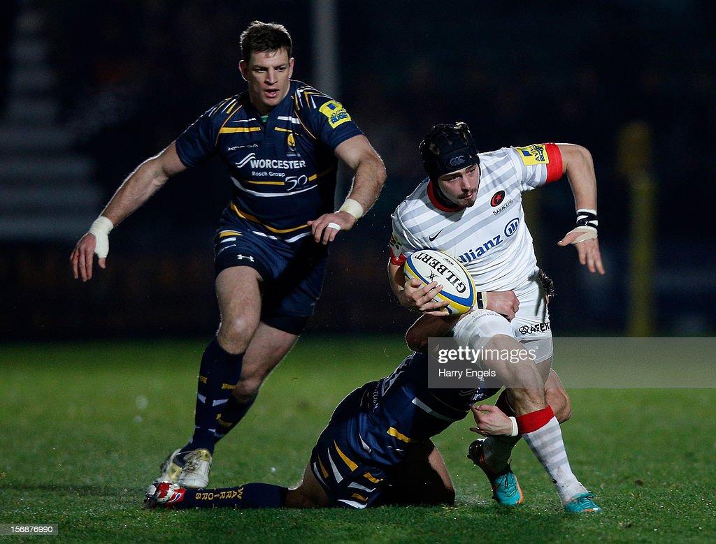 Ben Ransom of Saracens is tackled by the Worcester defence during the Aviva Premiership match between Worcester Warriors and Saracens at Sixways Stadium on November 23, 2012 in Worcester, England.