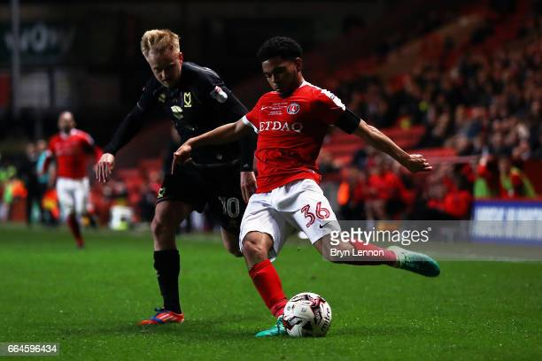 Ben Reeves of Milton Keynes Dons tackles Jay Dasilva of Charlton Athletic during the Sky Bet League One match between Charlton Athletic and Milton...