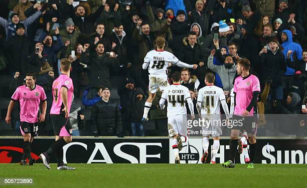 Ben Reeves of MK Dons celebrates scoring from the penalty spot during The Emirates FA Cup third round replay match between Milton Keynes Dons and...