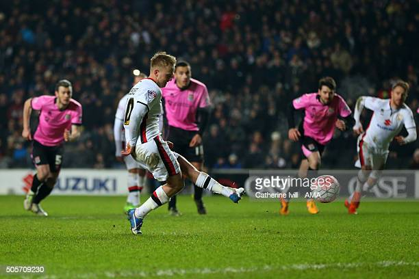 Ben Reeves of MK Dons scores a penalty goal to make it 10 during the Emirates FA Cup match between MK Dons and Northampton Town at Stadium mk on...
