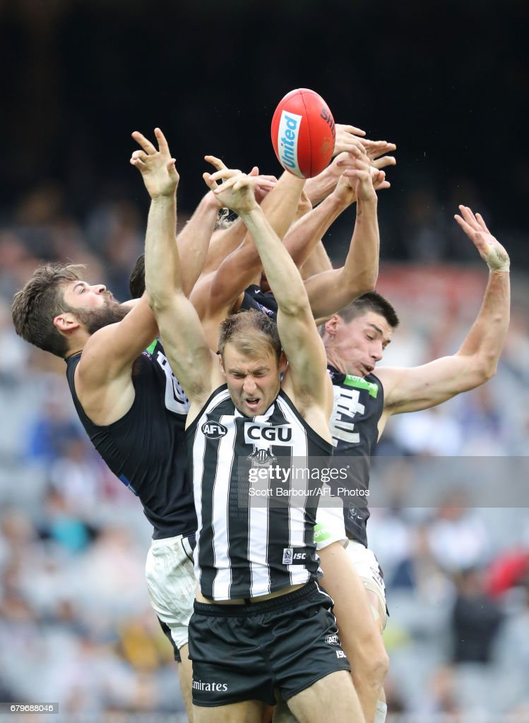 Ben Reid of the Magpies, Matthew Kreuzer of the Blues and Levi Casboult of the Blues compete for the ball during the round seven AFL match between the Collingwood Magpies and the Carlton Blues at Melbourne Cricket Ground on May 6, 2017 in Melbourne, Australia.
