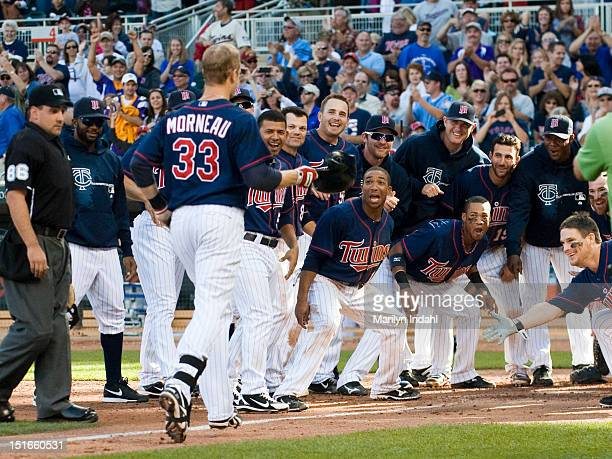 Ben Revere and all the Minnesota Twins celebrate a walk off home run by Justin Morneau of the Minnesota Twins in the ninth inning against the...