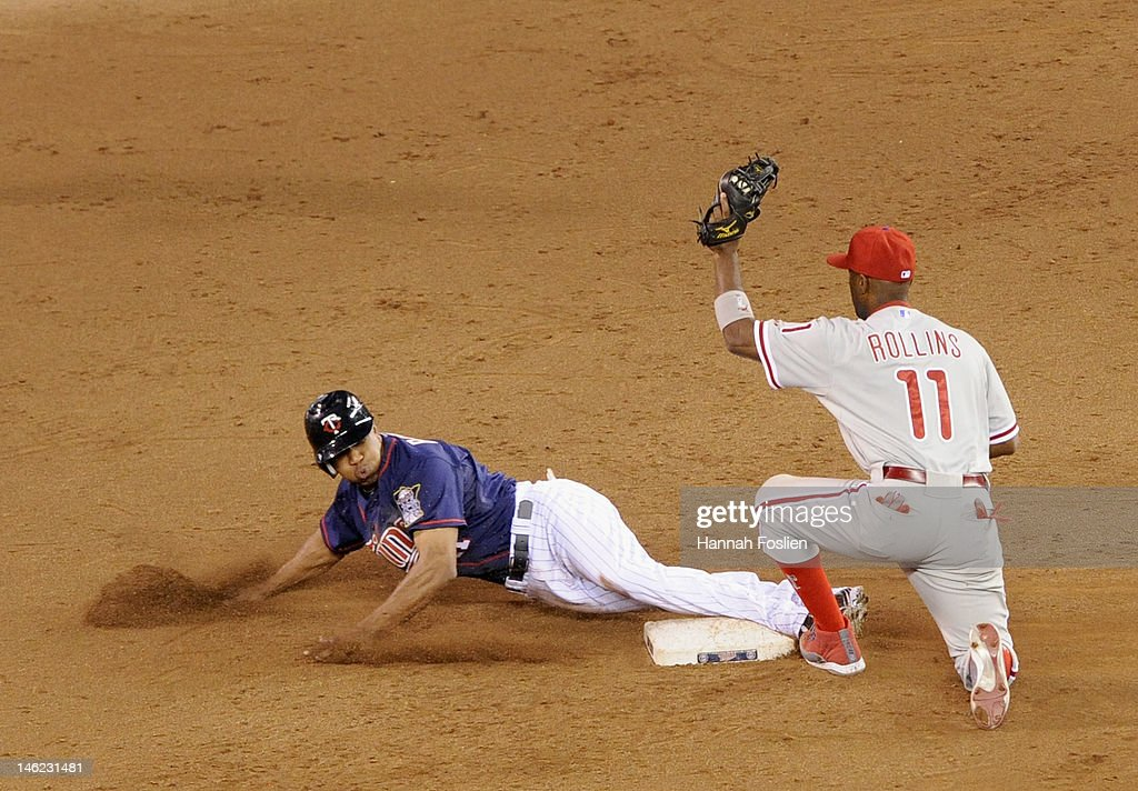 <a gi-track='captionPersonalityLinkClicked' href=/galleries/search?phrase=Ben+Revere&family=editorial&specificpeople=6826641 ng-click='$event.stopPropagation()'>Ben Revere</a> #11 of the Minnesota Twins is caught stealing second base by <a gi-track='captionPersonalityLinkClicked' href=/galleries/search?phrase=Jimmy+Rollins&family=editorial&specificpeople=204478 ng-click='$event.stopPropagation()'>Jimmy Rollins</a> #11 of the Philadelphia Phillies during the sixth inning on June 12, 2012 at Target Field in Minneapolis, Minnesota.