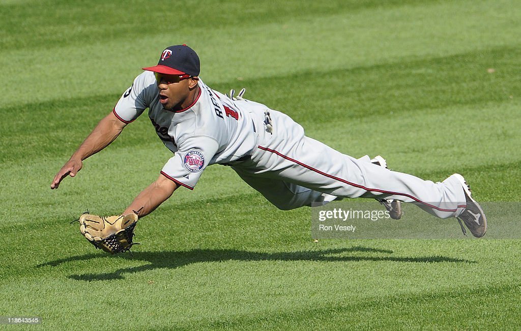 Ben Revere #11 of the Minnesota Twins makes a diving catch of a ball hit by <a gi-track='captionPersonalityLinkClicked' href=/galleries/search?phrase=Alex+Rios&family=editorial&specificpeople=224676 ng-click='$event.stopPropagation()'>Alex Rios</a> #51 of the Chicago White Sox in the seventh inning on July 9, 2011 at U.S. Cellular Field in Chicago, Illinois. The White Sox defeated the Twins 4-3.