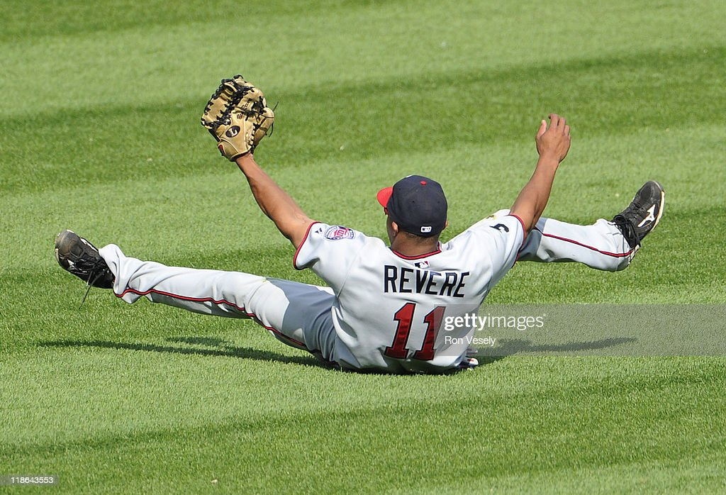 Ben Revere #11 of the Minnesota Twins makes a diving catch of a ball hit by Alex Rios #51 of the Chicago White Sox in the seventh inning on July 9, 2011 at U.S. Cellular Field in Chicago, Illinois. The White Sox defeated the Twins 4-3.