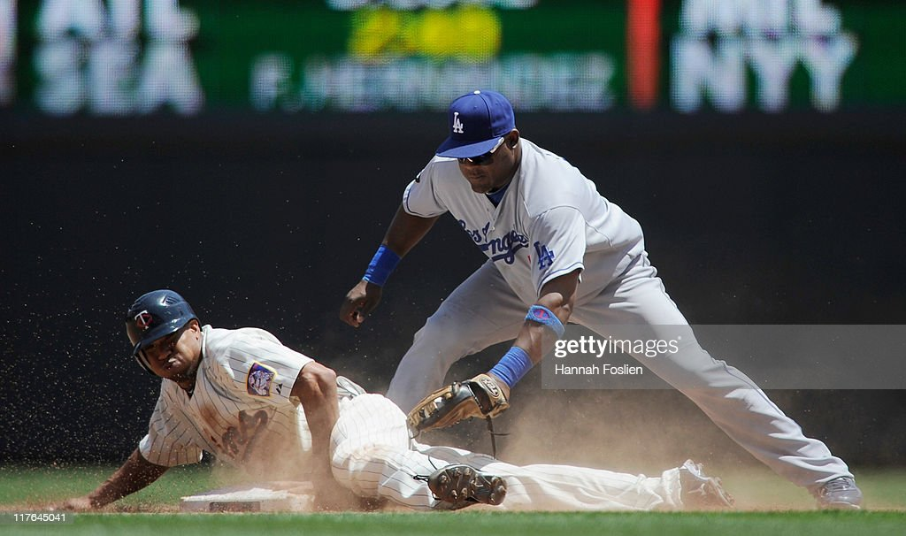 Ben Revere #11 of the Minnesota Twins steals second under <a gi-track='captionPersonalityLinkClicked' href=/galleries/search?phrase=Juan+Uribe&family=editorial&specificpeople=209187 ng-click='$event.stopPropagation()'>Juan Uribe</a> #5 of the Los Angeles Dodgers tag in the fifth inning on June 29, 2011 at Target Field in Minneapolis, Minnesota. The Twins defeated the Dodgers 1-0.
