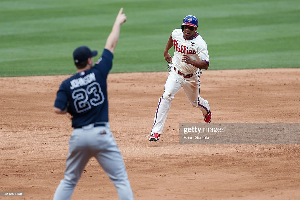 <a gi-track='captionPersonalityLinkClicked' href=/galleries/search?phrase=Ben+Revere&family=editorial&specificpeople=6826641 ng-click='$event.stopPropagation()'>Ben Revere</a> #2 of the Philadelphia Phillies advances to third off of Tony Gwynn #19 single in the fifth inning of the first game of a doubleheader against the Atlanta Braves at Citizens Bank Park on June 28, 2014 in Philadelphia, Pennsylvania.