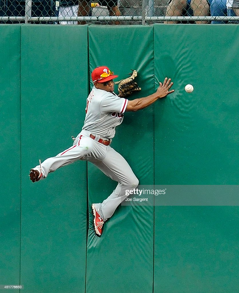 <a gi-track='captionPersonalityLinkClicked' href=/galleries/search?phrase=Ben+Revere&family=editorial&specificpeople=6826641 ng-click='$event.stopPropagation()'>Ben Revere</a> #2 of the Philadelphia Phillies can't make a catch on a ball hit by Andrew McCutchen #22 of the Pittsburgh Pirates during the eighth inning on July 6, 2014 at PNC Park in Pittsburgh, Pennsylvania. Pittsburgh won the game 6-2.