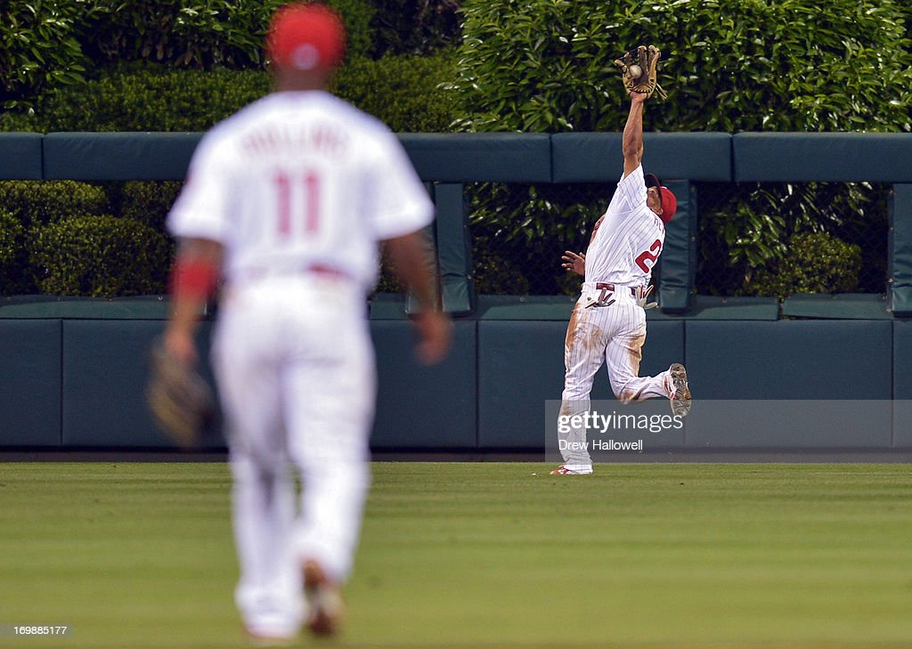 <a gi-track='captionPersonalityLinkClicked' href=/galleries/search?phrase=Ben+Revere&family=editorial&specificpeople=6826641 ng-click='$event.stopPropagation()'>Ben Revere</a> #2 of the Philadelphia Phillies catches a deep fly ball in the sixth inning against the Miami Marlins as teammate \pp11#32\ watches at Citizens Bank Park on June 3, 2013 in Philadelphia, Pennsylvania. The Phillies won 7-2.