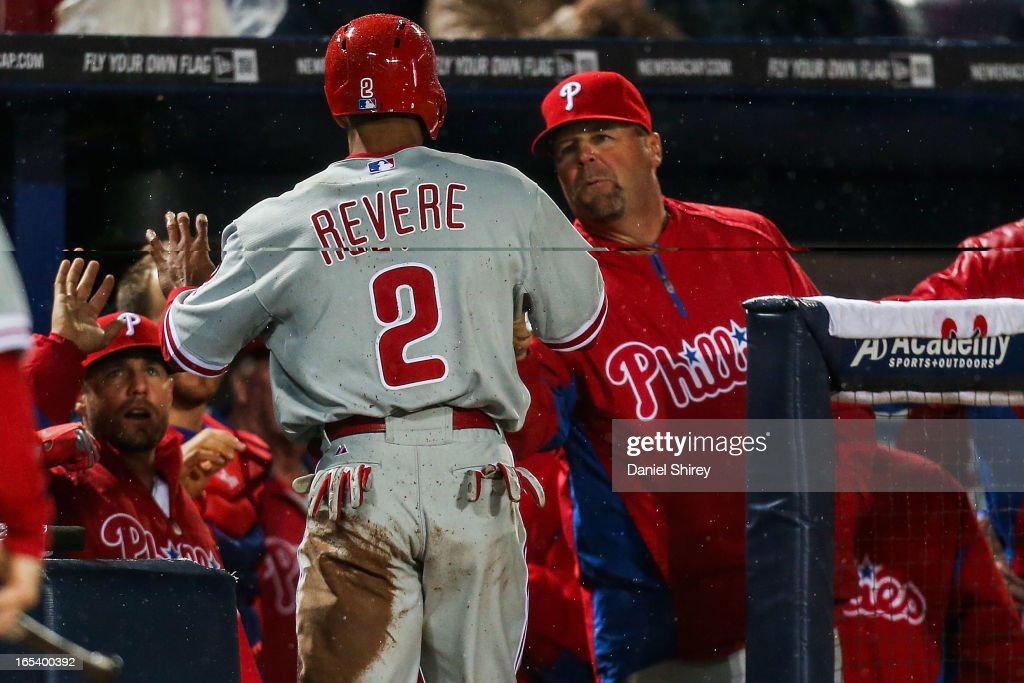 <a gi-track='captionPersonalityLinkClicked' href=/galleries/search?phrase=Ben+Revere&family=editorial&specificpeople=6826641 ng-click='$event.stopPropagation()'>Ben Revere</a> #2 of the Philadelphia Phillies celebrates scoring a run with teammates in the seventh inning of the game against the Atlanta Braves at Turner Field on April 3, 2013 in Atlanta, Georgia.