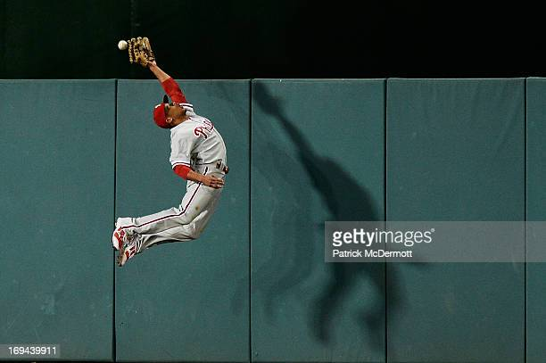 Ben Revere of the Philadelphia Phillies fails to catch a RBI triple hit by Adam LaRoche of the Washington Nationals in the fifth inning during a game...
