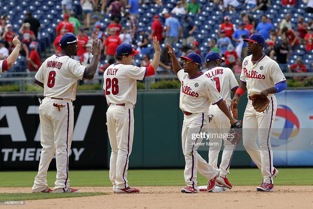 <a gi-track='captionPersonalityLinkClicked' href=/galleries/search?phrase=Ben+Revere&family=editorial&specificpeople=6826641 ng-click='$event.stopPropagation()'>Ben Revere</a> #2 of the Philadelphia Phillies high fives <a gi-track='captionPersonalityLinkClicked' href=/galleries/search?phrase=Chase+Utley&family=editorial&specificpeople=161391 ng-click='$event.stopPropagation()'>Chase Utley</a> #26 after beating the Arizona Diamondbacks at Citizens Bank Park on July 27, 2014 in Philadelphia, Pennsylvania. The Phillies won 4-2.