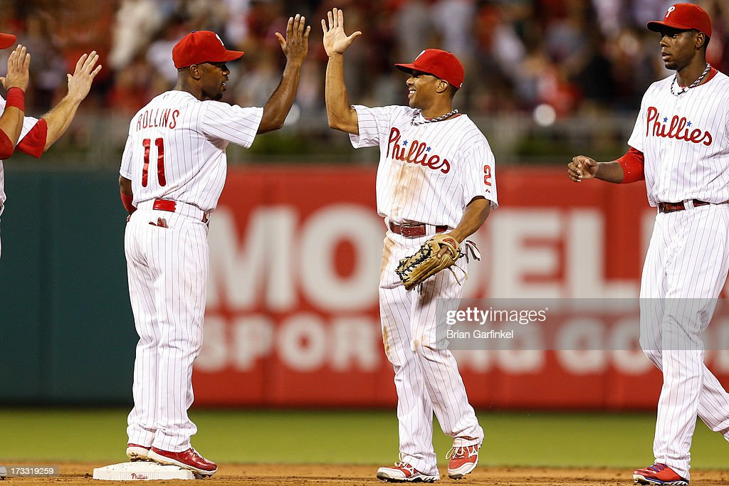 <a gi-track='captionPersonalityLinkClicked' href=/galleries/search?phrase=Ben+Revere&family=editorial&specificpeople=6826641 ng-click='$event.stopPropagation()'>Ben Revere</a> #2 of the Philadelphia Phillies high fives <a gi-track='captionPersonalityLinkClicked' href=/galleries/search?phrase=Jimmy+Rollins&family=editorial&specificpeople=204478 ng-click='$event.stopPropagation()'>Jimmy Rollins</a> #11 after the game against the Washington Nationals at Citizens Bank Park on July 11, 2013 in Philadelphia, Pennsylvania. Phillies won 3-1.