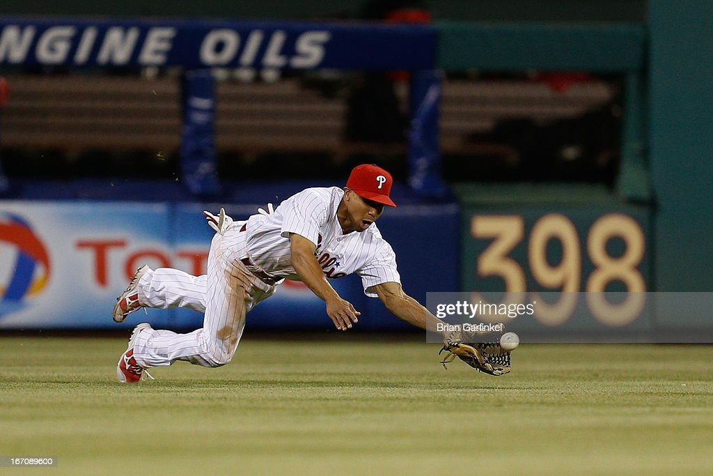 <a gi-track='captionPersonalityLinkClicked' href=/galleries/search?phrase=Ben+Revere&family=editorial&specificpeople=6826641 ng-click='$event.stopPropagation()'>Ben Revere</a> #2 of the Philadelphia Phillies makes a diving catch in the sixth inning of the game against the St. Louis Cardinals at Citizens Bank Park on April 19, 2013 in Philadelphia, Pennsylvania.