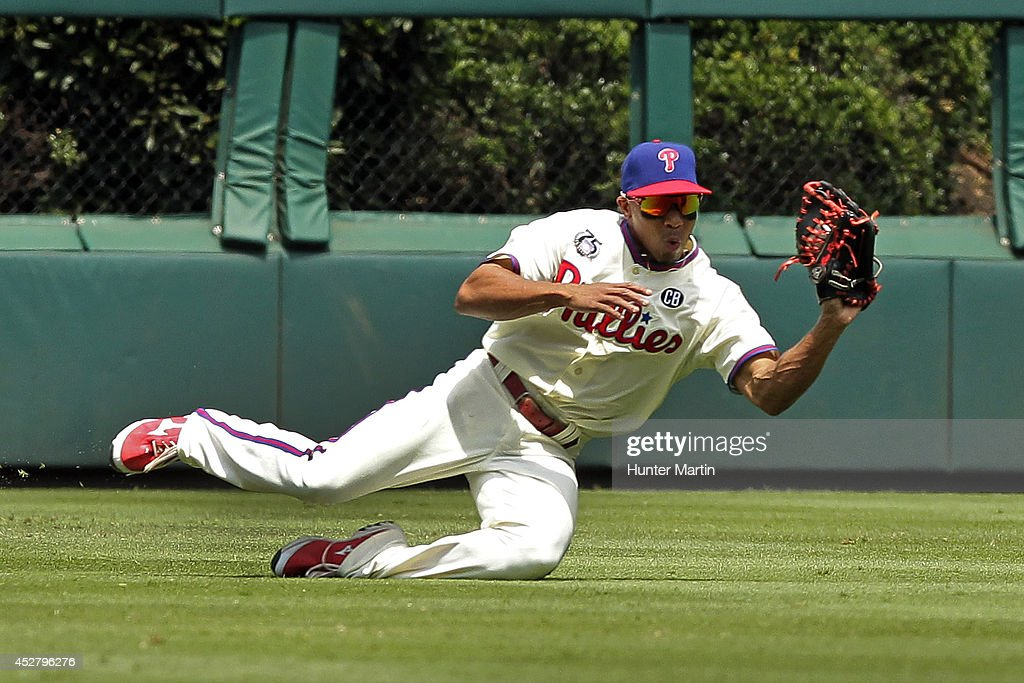 <a gi-track='captionPersonalityLinkClicked' href=/galleries/search?phrase=Ben+Revere&family=editorial&specificpeople=6826641 ng-click='$event.stopPropagation()'>Ben Revere</a> #2 of the Philadelphia Phillies makes a diving catch in the first inning during a game against the Arizona Diamondbacks at Citizens Bank Park on July 27, 2014 in Philadelphia, Pennsylvania.