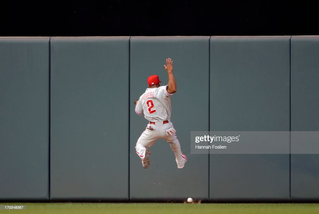 <a gi-track='captionPersonalityLinkClicked' href=/galleries/search?phrase=Ben+Revere&family=editorial&specificpeople=6826641 ng-click='$event.stopPropagation()'>Ben Revere</a> #2 of the Philadelphia Phillies misses a catch of the ball hit by Oswaldo Arcia #31 of the Minnesota Twins during the fourth inning of the game on June 11, 2013 at Target Field in Minneapolis, Minnesota.