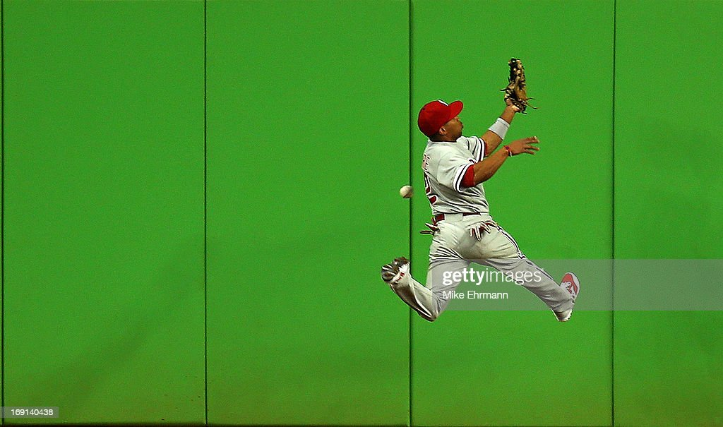 <a gi-track='captionPersonalityLinkClicked' href=/galleries/search?phrase=Ben+Revere&family=editorial&specificpeople=6826641 ng-click='$event.stopPropagation()'>Ben Revere</a> #2 of the Philadelphia Phillies misses a fly ball during a game against the Miami Marlins at Marlins Park on May 20, 2013 in Miami, Florida.