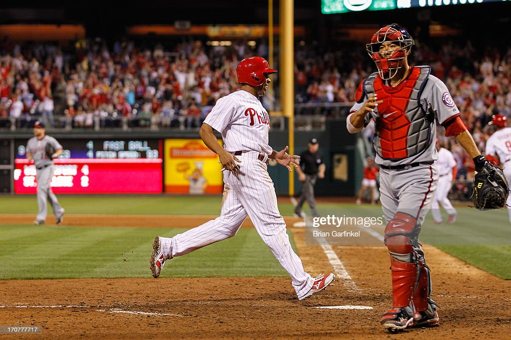<a gi-track='captionPersonalityLinkClicked' href=/galleries/search?phrase=Ben+Revere&family=editorial&specificpeople=6826641 ng-click='$event.stopPropagation()'>Ben Revere</a> #2 of the Philadelphia Phillies scores a run on a Domonic Brown (not pictured) RBI single in the bottom of the ninth to win the game against the Washington Nationals at Citizens Bank Park on June 17, 2013 in Philadelphia, Pennsylvania. The Phillies won 5-4.