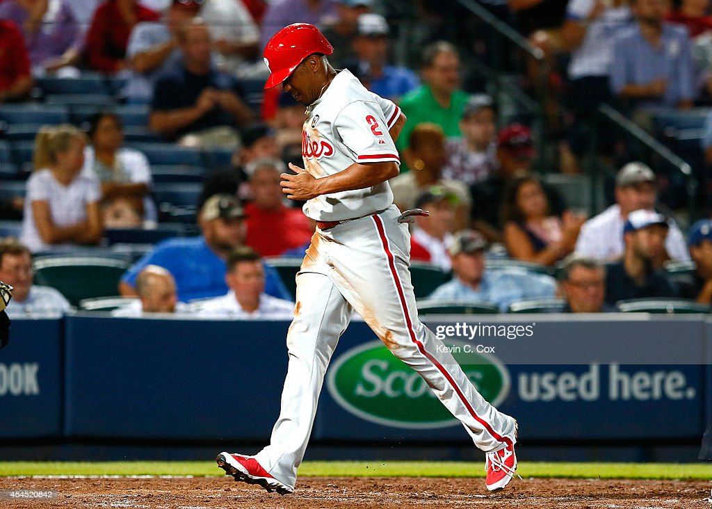 <a gi-track='captionPersonalityLinkClicked' href=/galleries/search?phrase=Ben+Revere&family=editorial&specificpeople=6826641 ng-click='$event.stopPropagation()'>Ben Revere</a> #2 of the Philadelphia Phillies scores in the sixth inning off a single by Darin Ruf #18 against the Atlanta Braves at Turner Field on September 2, 2014 in Atlanta, Georgia.