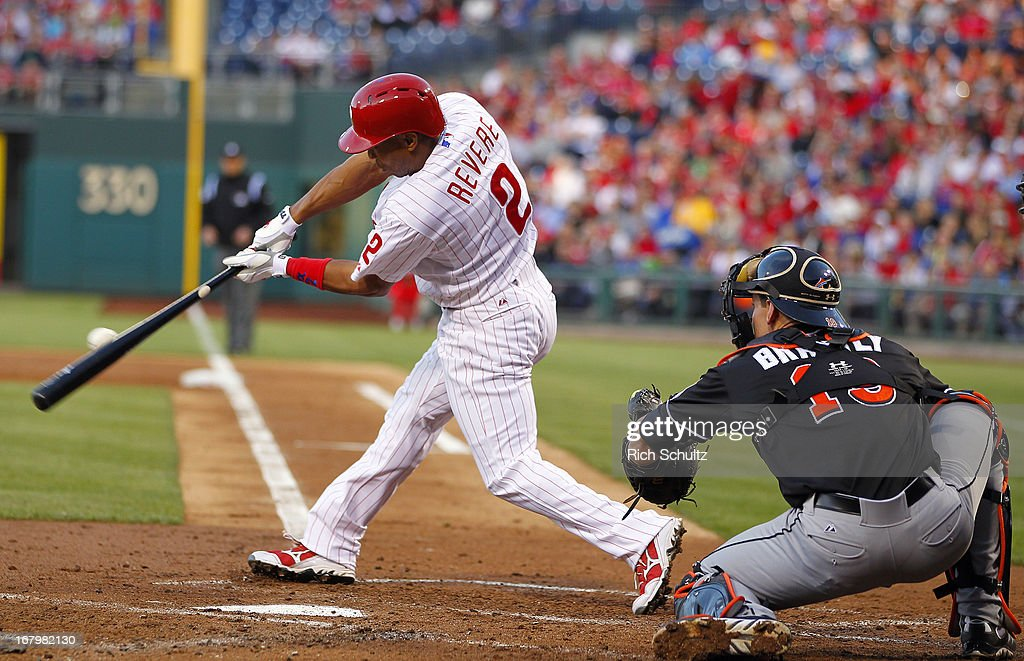 <a gi-track='captionPersonalityLinkClicked' href=/galleries/search?phrase=Ben+Revere&family=editorial&specificpeople=6826641 ng-click='$event.stopPropagation()'>Ben Revere</a> #2 of the Philadelphia Phillies singles in the second inning scoring teammate Carlos Ruiz #51 against the Miami Marlins in a MLB baseball game on May 3, 2013 at Citizens Bank Park in Philadelphia, Pennsylvania.