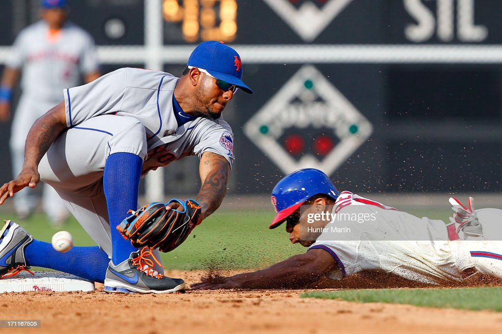 Ben Revere #2 of the Philadelphia Phillies steals second base as Jordany Valdespin #1 of the New York Mets drops the ball during a game at Citizens Bank Park on June 22, 2013 in Philadelphia, Pennsylvania. The Phillies won 8-7.
