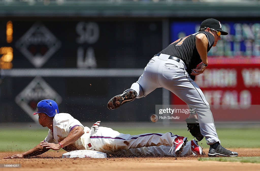 <a gi-track='captionPersonalityLinkClicked' href=/galleries/search?phrase=Ben+Revere&family=editorial&specificpeople=6826641 ng-click='$event.stopPropagation()'>Ben Revere</a> #2 of the Philadelphia Phillies steals second base as the ball gets past second baseman Derek Dietrich #51 of the Miami Marlins during the second inning of a game on June 5, 2013 at Citizens Bank Park in Philadelphia, Pennsylvania.