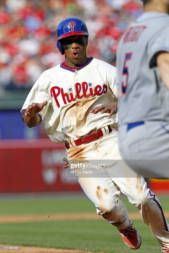 <a gi-track='captionPersonalityLinkClicked' href=/galleries/search?phrase=Ben+Revere&family=editorial&specificpeople=6826641 ng-click='$event.stopPropagation()'>Ben Revere</a> #2 of the Philadelphia Phillies steals third base during a game against the New York Mets at Citizens Bank Park on June 22, 2013 in Philadelphia, Pennsylvania. The Phillies won 8-7.