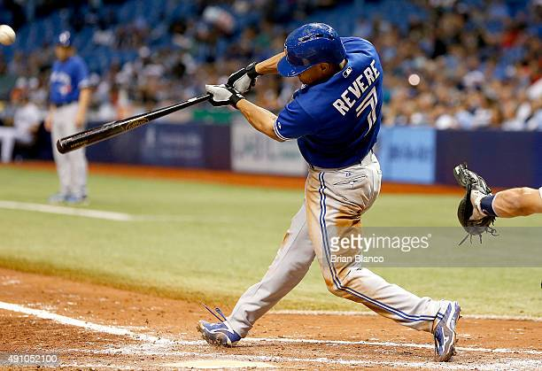 Ben Revere of the Toronto Blue Jays hits a sacrifice fly to right field to score Ryan Goins during the sixth inning of a game on October 2 2015 at...