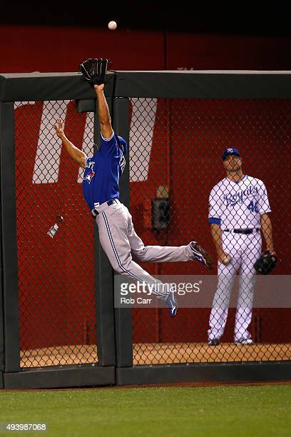 Ben Revere of the Toronto Blue Jays makes a leaping catch at the wall on a ball hit by Salvador Perez of the Kansas City Royals in the seventh inning...