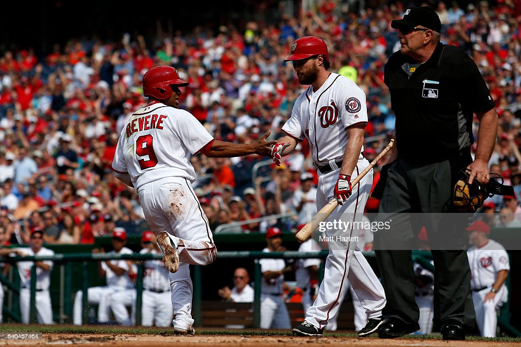 Ben Revere of the Washington Nationals celebrates with teammate Daniel Murphy after scoring off of an overthrown pitch in the first inning against...