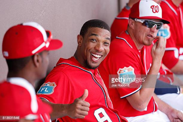 Ben Revere of the Washington Nationals jokes around in the dugout during a spring training game against the New York Mets at Space Coast Stadium on...