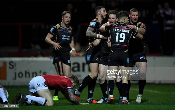 Ben Reynolds of Leigh celebrates with teammates after scoring the opening try during the Betfred Super League match between Wakefield Trinity and...