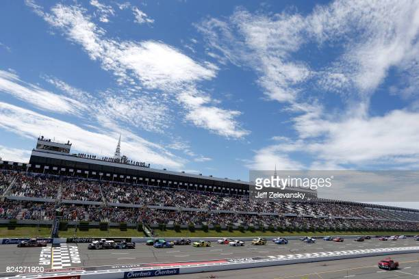 Ben Rhodes driver of the Safelite Auto Glass Toyota leads the field to the green flag during the NASCAR Camping World Truck Series Overton's 150 at...