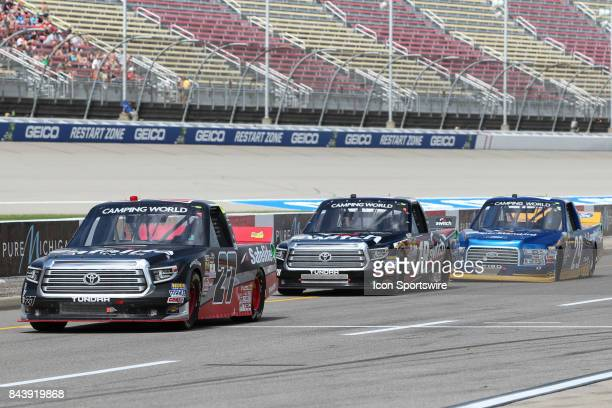 Ben Rhodes driver of the Safelite Auto Glass Toyota Noah Gragson driver of the Switch Toyota and Chase Briscoe driver of the Cooper Standard Ford...
