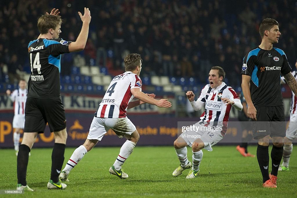 Ben Rienstra of Heracles Almelo, Jordens Peters of Willem II, Ricardo Ippel of Willem II, Christian Dorda of Heracles Almelo during the Dutch Eredivisie match between Willem II and Heracles Almelo at the Koning Willem II Stadium on November 24, 2012 in Tilburg, The Netherlands.