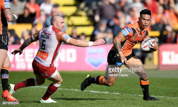 Ben Roberts of Castleford gets past Luke Walsh of Catalans during the Betfred Super League match between Castleford Tigers and Catalans Dragons at...
