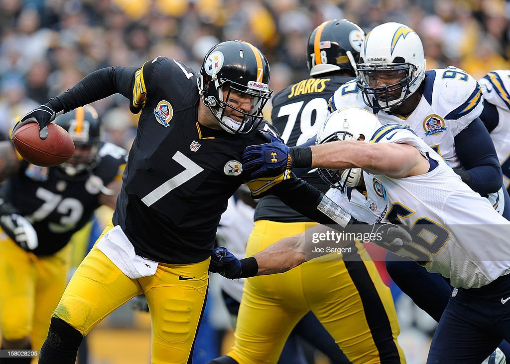 Ben Roethlisberger #7 of the Pittsburgh Steelers avoids a sacks by Jarret Johnson #96 of the San Diego Chargers on December 9, 2012 at Heinz Field in Pittsburgh, Pennsylvania.