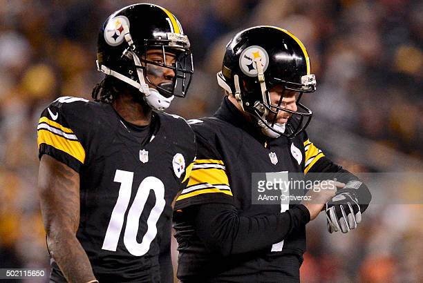 Ben Roethlisberger of the Pittsburgh Steelers checks his plays as he and Martavis Bryant take the field against the Denver Broncos during the first...