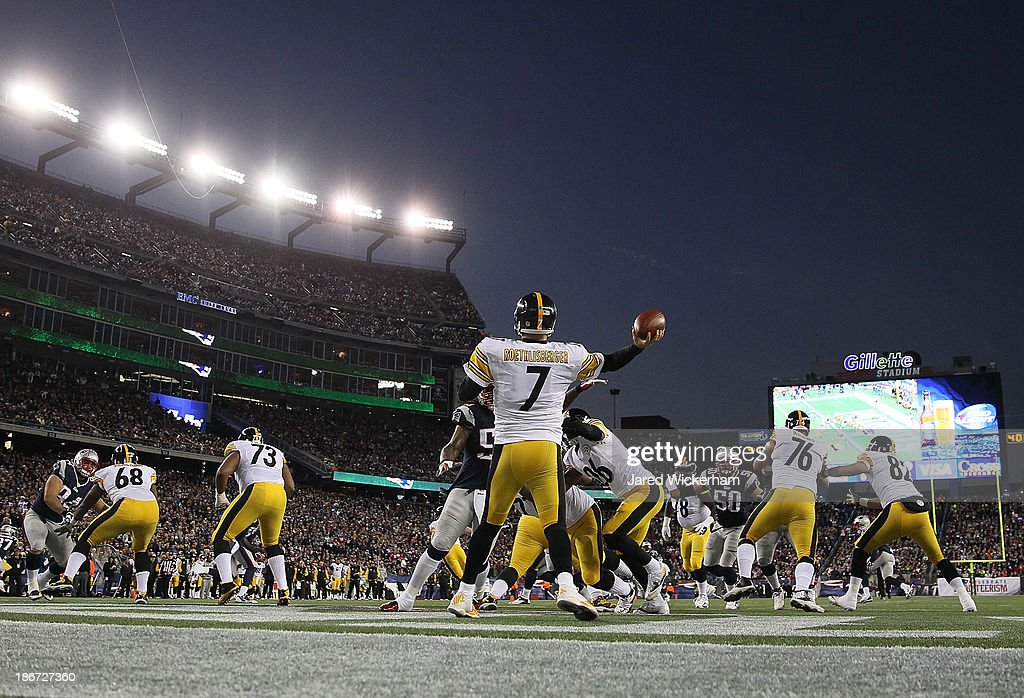 Ben Roethlisberger of the Pittsburgh Steelers drops back to pass in the endzone against the New England Patriots in the first quarter at Gillette...