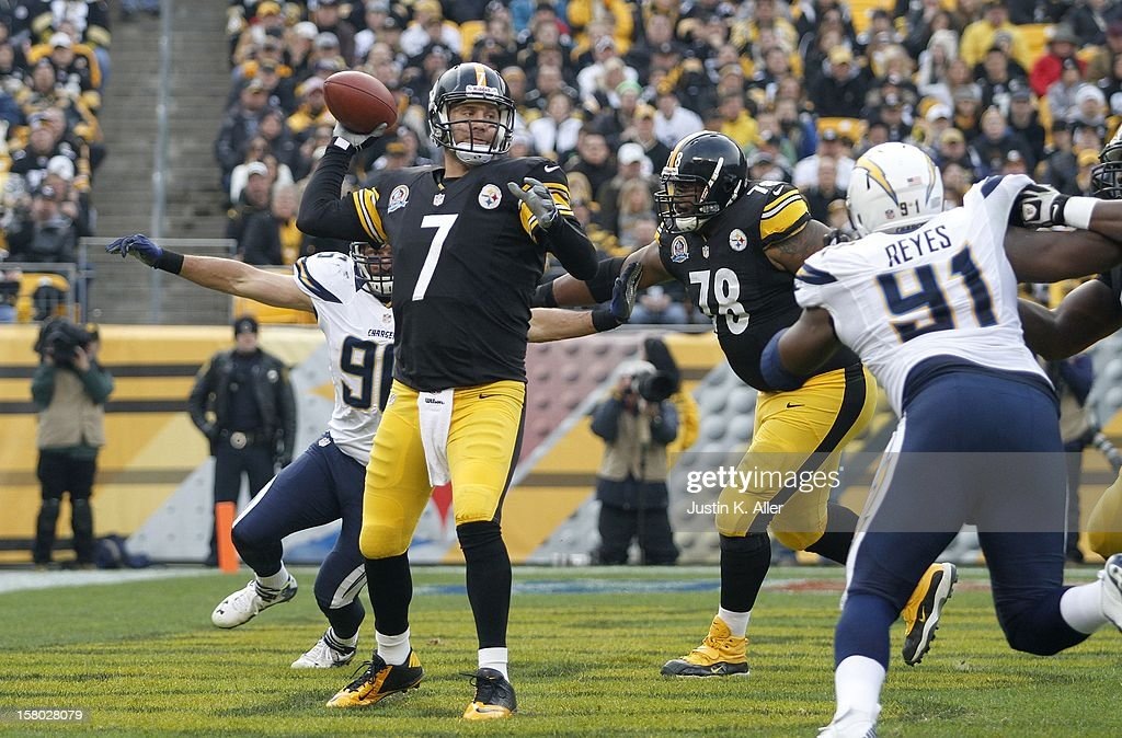 Ben Roethlisberger #7 of the Pittsburgh Steelers drops back to pass under pressure against the San Diego Chargers during the game on December 9, 2012 at Heinz Field in Pittsburgh, Pennsylvania.