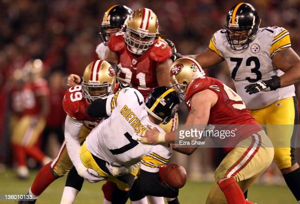 Ben Roethlisberger of the Pittsburgh Steelers fumbles the ball after being sacked by Aldon Smith and Justin Smith of the San Francisco 49ers at...