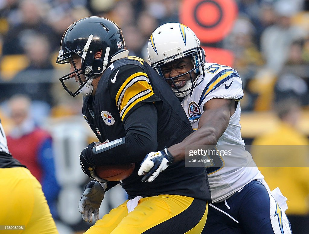 Ben Roethlisberger #7 of the Pittsburgh Steelers gets sacked by Marcus Gilchrist #38 of the San Diego Chargers during the second quarter on December 9, 2012 at Heinz Field in Pittsburgh, Pennsylvania.