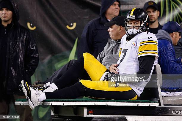 Ben Roethlisberger of the Pittsburgh Steelers is carted off the field after being injured in the third quarter against the Cincinnati Bengals during...