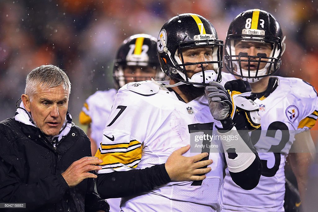 Ben Roethlisberger of the Pittsburgh Steelers is helped off the field after being injured in the third quarter against the Cincinnati Bengals during...