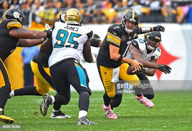 Ben Roethlisberger of the Pittsburgh Steelers is pressured by Calais Campbell of the Jacksonville Jaguars and Abry Jones in the second half during...
