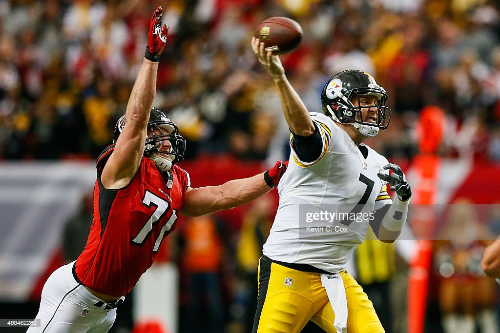 <a gi-track='captionPersonalityLinkClicked' href=/galleries/search?phrase=Ben+Roethlisberger&family=editorial&specificpeople=201605 ng-click='$event.stopPropagation()'>Ben Roethlisberger</a> #7 of the Pittsburgh Steelers is pressured by <a gi-track='captionPersonalityLinkClicked' href=/galleries/search?phrase=Kroy+Biermann&family=editorial&specificpeople=5085129 ng-click='$event.stopPropagation()'>Kroy Biermann</a> #71 of the Atlanta Falcons in the first half at the Georgia Dome on December 14, 2014 in Atlanta, Georgia.