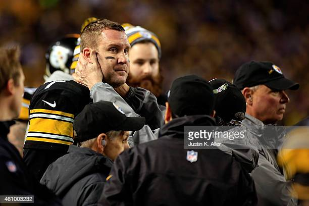 Ben Roethlisberger of the Pittsburgh Steelers is tested for a concussion on the sideline in the fourth quarter against the Baltimore Ravens during...
