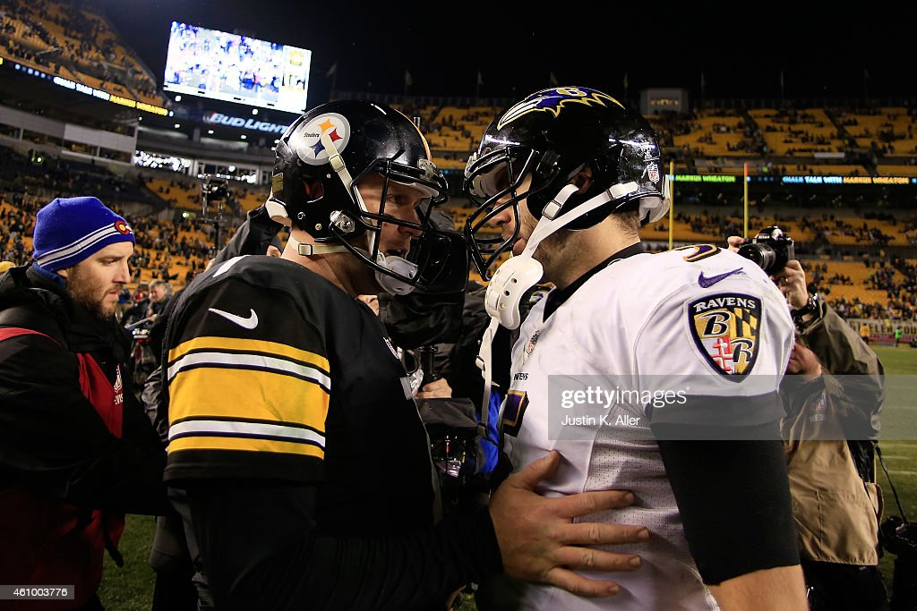Ben Roethlisberger #7 of the Pittsburgh Steelers meets Joe Flacco #5 of the Baltimore Ravens after the Ravens defeated the Steelers 30-17 in their AFC Wild Card game at Heinz Field on January 3, 2015 in Pittsburgh, Pennsylvania.