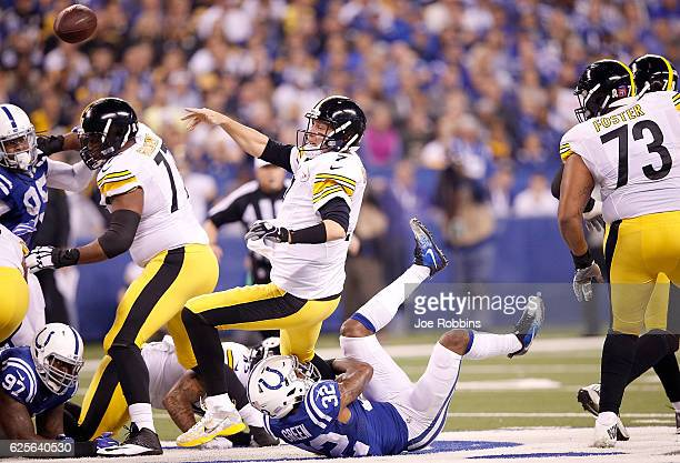 Ben Roethlisberger of the Pittsburgh Steelers passes the ball while being tackled by TJ Green of the Indianapolis Colts during the first quarter of...