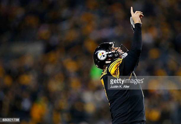 Ben Roethlisberger of the Pittsburgh Steelers points to the sky after a rushing touchdown by Le'Veon Bell in the fourth quarter during the game...
